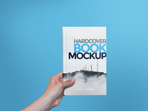 25 Hardcover Book in Hand Mockup